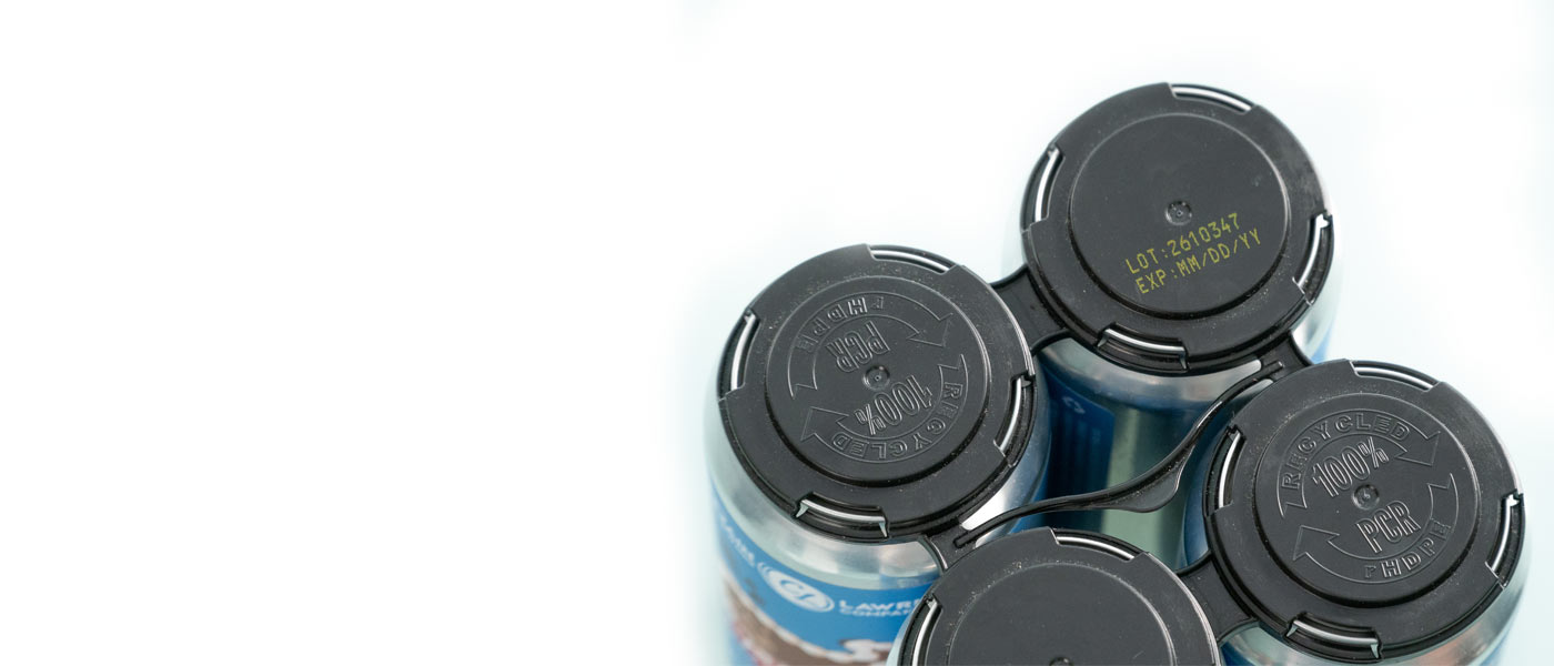 black plastic holders for canned beer with yellow ink