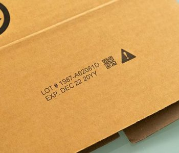cardboard with lot number, expiration date, qr code, and graphic