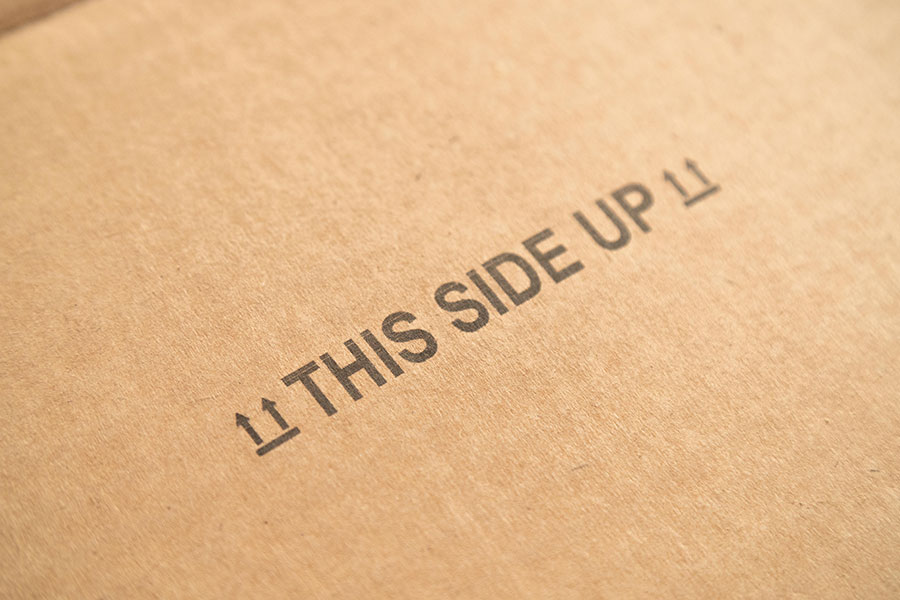 "cardboard with ""This Side Up"" graphic"