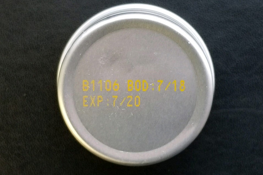 Metal jar cap yellow ink expiration date