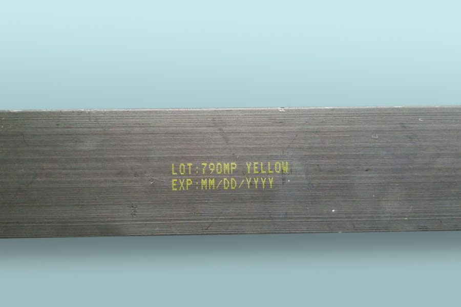 metal part with yellow ink lot number expiration date