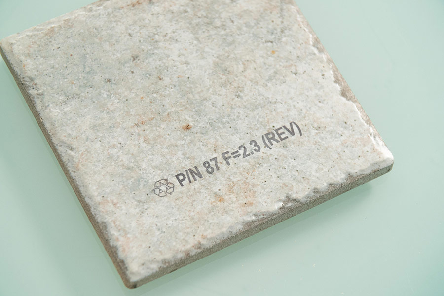 clay tile with graphic and part number