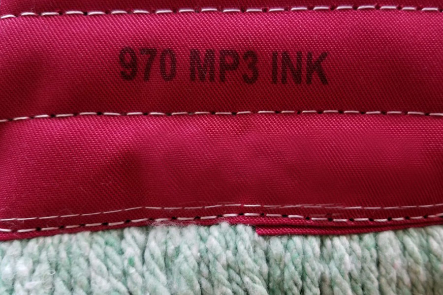 textile, red fabric with 970 mp3 ink marked on it