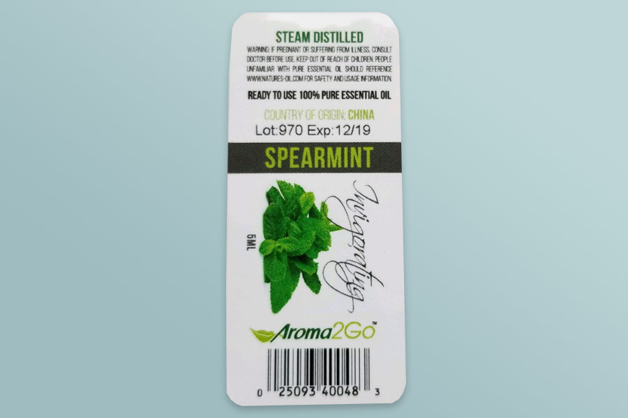 paper sticker for spearmint essential oil with lot number and expiration date