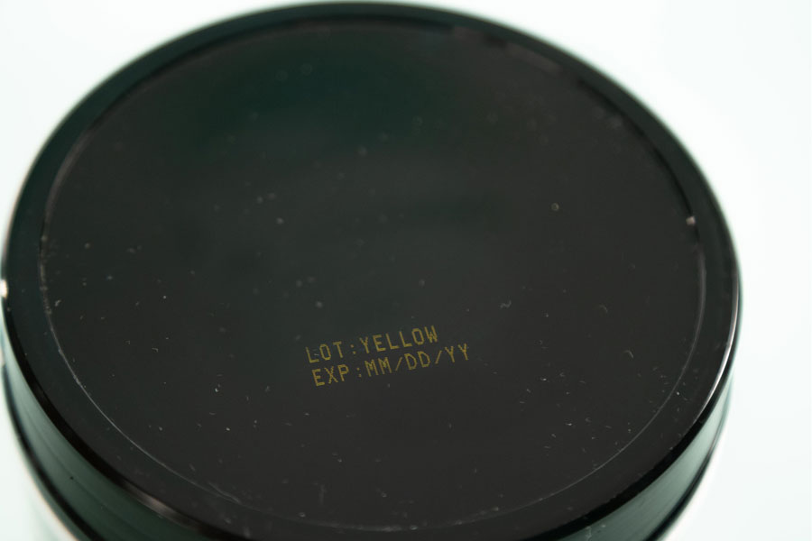 plastic black cap with yellow ink
