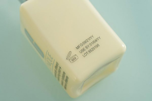 plastic lotion bottle square with graphic, lot number and dates
