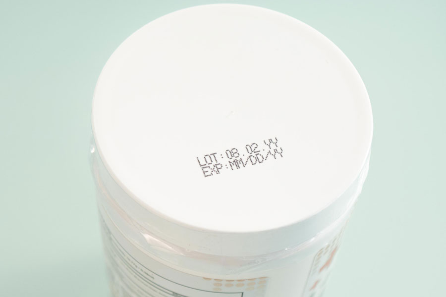 plastic vitamin tub with lot and expiration imprints