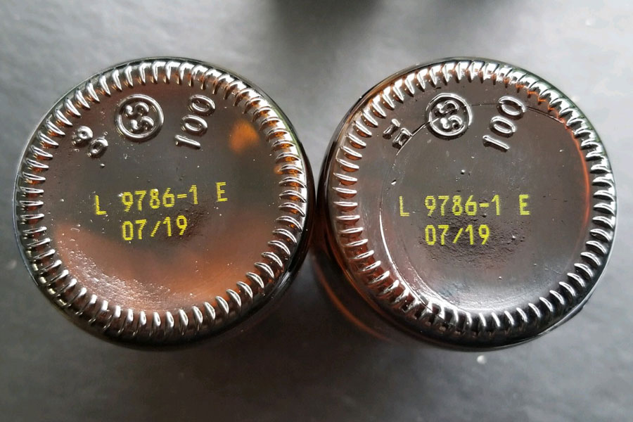 glass bottles' bottom with yellow ink of lot number and date