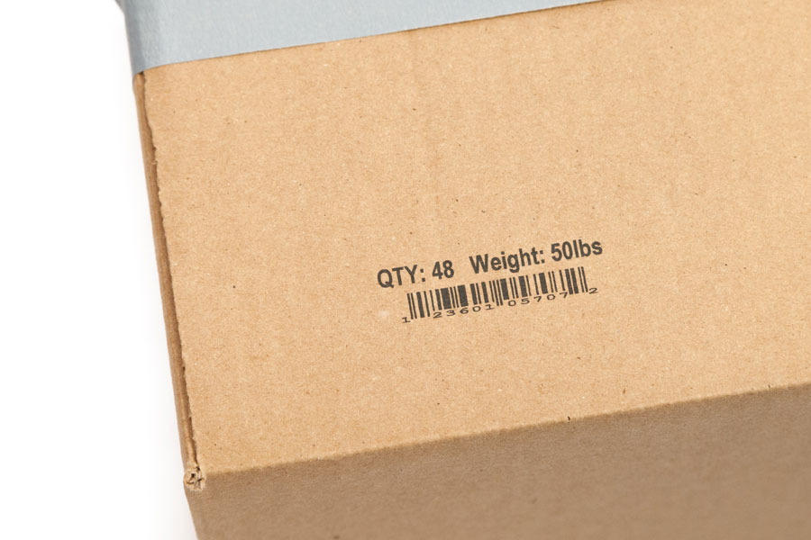 cardboard box with barcode, weight, and quantity