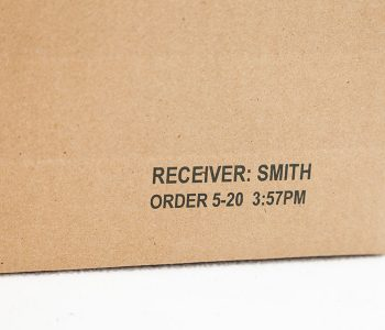 cardboard box with receiver name and order date time
