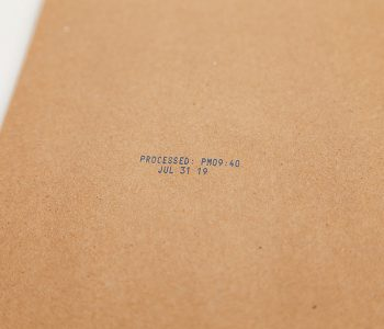 cardboard with processed date