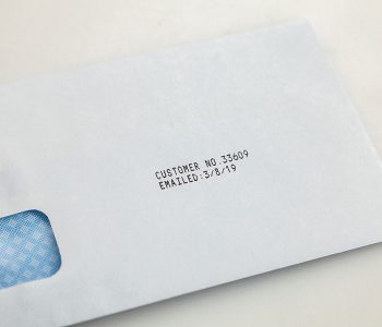 envelope with customer number and email date