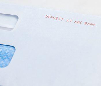 envelope with deposit imprint in red ink