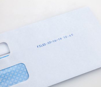 envelope with filed date and time in blue ink