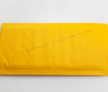 yellow padded envelope processed date and name