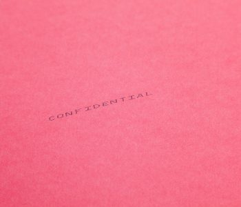 pink folder with confidential printed on it