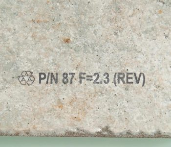 tile with graphic and part number on it