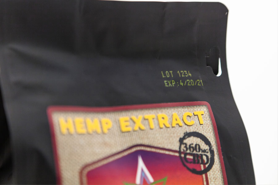 hemp extract CBD pouch with yellow ink of lot number and expiration date