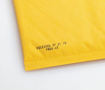 yellow padded envelope with received date