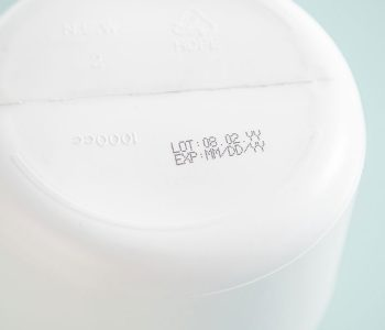 plastic container bottom with lot and expiration date