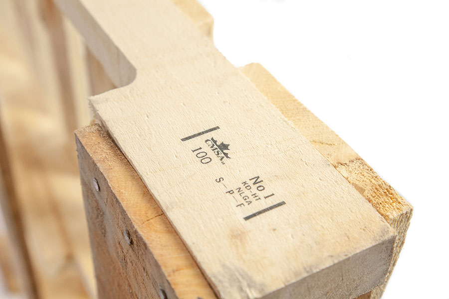 wooden pallet with graphic and alphanumerics